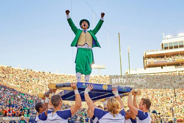 Notre Dame Fighting Irish mascot The Leprechaun celebrates with the cheerleaders after a touchdown during the college football game between the Notre...