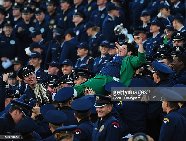 Notre Dame Fighting Irish masot Lucky The Leprechaun crowd surfs through Cadets during the game against the Air Force Falcons at Falcon Stadium on...