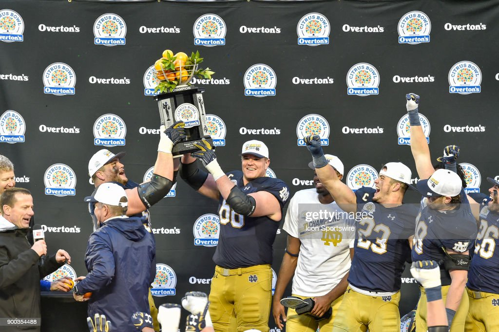Notre Dame Fighting Irish offensive lineman Quenton Nelson (56) and Notre Dame Fighting Irish offensive lineman Mike McGlinchey (68) hold up the trophy during the award ceremony of the Citrus Bowl game between the Notre Dame Fighting Irish and the LSU Tigers on January 01, 2018, at Camping World Stadium in Orlando, FL. Notre Dame defeated LSU