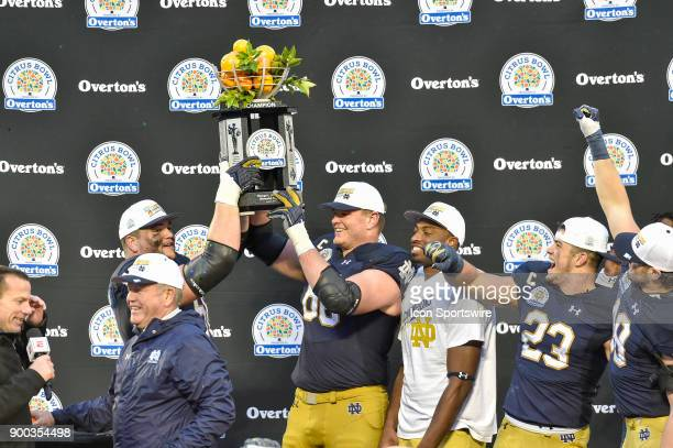 Notre Dame Fighting Irish offensive lineman Quenton Nelson and Notre Dame Fighting Irish offensive lineman Mike McGlinchey hold up the trophy during...