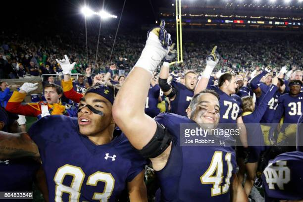 Notre Dame Fighting Irish players celebrate after a 4914 win against the USC Trojans at Notre Dame Stadium on October 21 2017 in South Bend Indiana