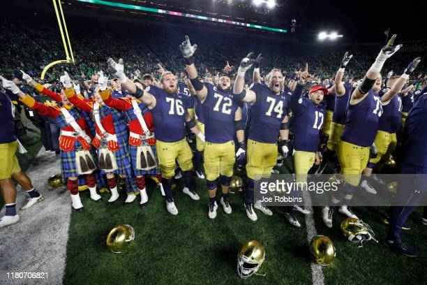 Notre Dame Fighting Irish players celebrate after the game against the USC Trojans at Notre Dame Stadium on October 12 2019 in South Bend Indiana...