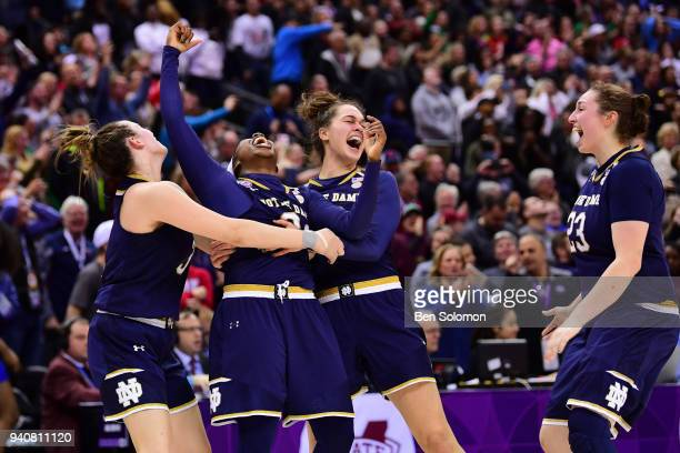 Notre Dame Fighting Irish players celebrate winning the championship against the Mississippi State Bulldogs at Nationwide Arena April 1, 2018 in...
