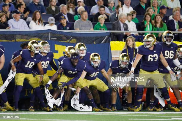 Notre Dame Fighting Irish players react on the sideline in the first quarter of a game against the USC Trojans at Notre Dame Stadium on October 21...