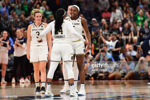 Notre Dame Fighting Irish players react to beating the Connecticut Huskies at Amalie Arena on April 5 2019 in Tampa Florida