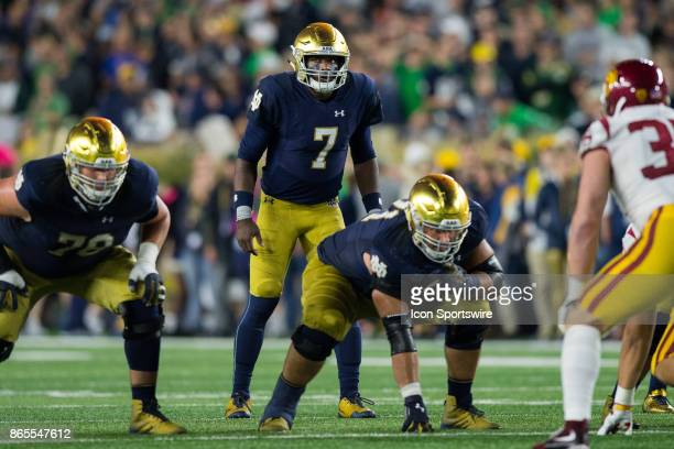 Notre Dame Fighting Irish quarterback Brandon Wimbush looks up at the play clock before the snap during the college football game between the Notre...