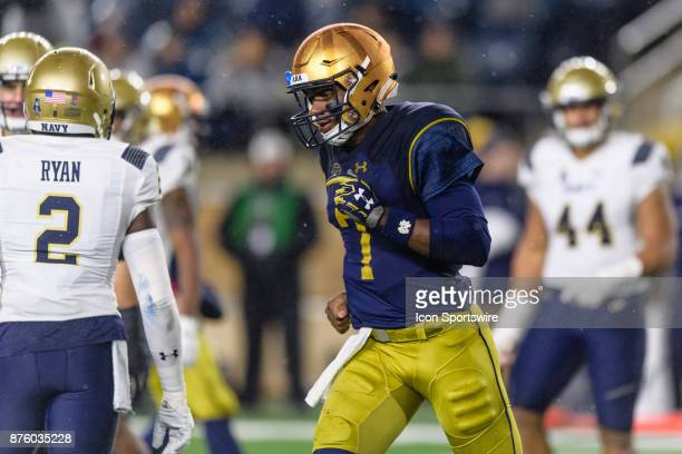 Notre Dame Fighting Irish quarterback Brandon Wimbush runs off the field after throwing a touchdown to Notre Dame Fighting Irish wide receiver Kevin...
