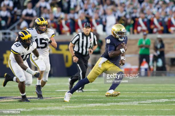 Notre Dame Fighting Irish quarterback Brandon Wimbush runs with the ball while being pursued by Michigan Wolverines defensive lineman Chase Winovich...