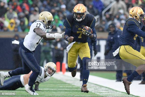 Notre Dame Fighting Irish quarterback Brandon Wimbush runs with the football during the college football game between the Notre Dame Fighting Irish...