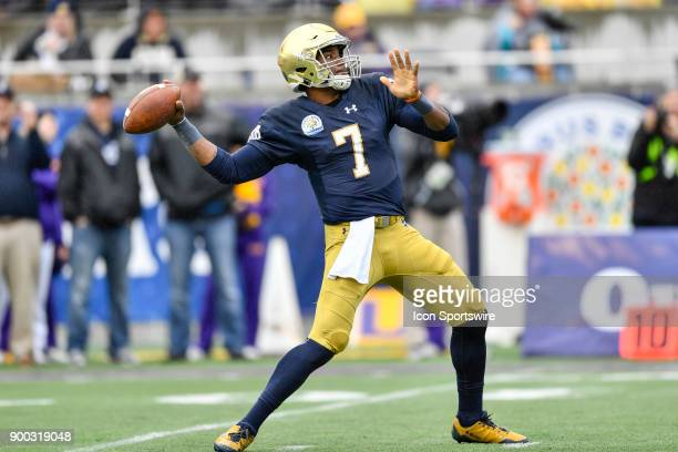 Notre Dame Fighting Irish quarterback Brandon Wimbush throws a deep pass during the first half of the Citrus Bowl game between the Notre Dame...