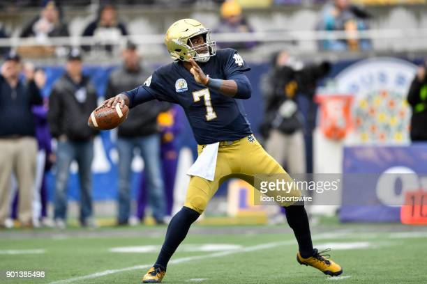 Notre Dame Fighting Irish quarterback Brandon Wimbush throws a pass during the first half of the Citrus Bowl game between the Notre Dame Fighting...