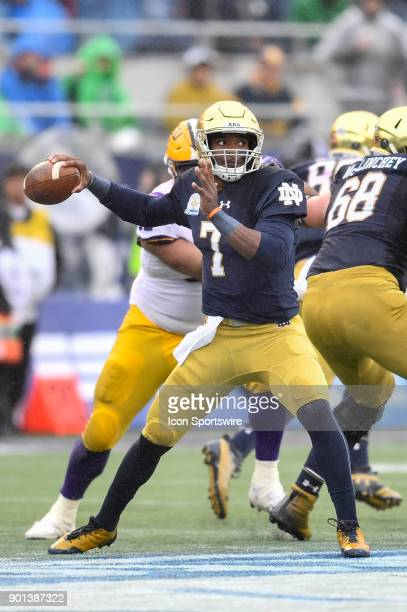 Notre Dame Fighting Irish quarterback Brandon Wimbush throws a pass backwards on a trick play during the first half of the Citrus Bowl game between...