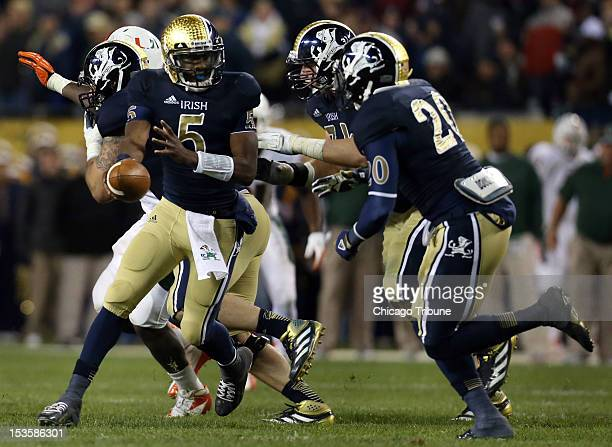 Notre Dame Fighting Irish quarterback Everett Golson hands the ball off to Notre Dame running back Cierre Wood during the second quarter against...
