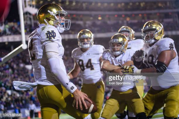 Notre Dame Fighting Irish quarterback Ian Book celebrates after rushing for a touchdown in the 4th quarter during a college football game between the...