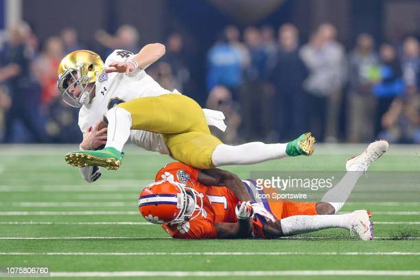 Notre Dame Fighting Irish quarterback Ian Book is hit by Clemson Tigers cornerback Trayvon Mullen during the CFP Semifinal Cotton Bowl Classic game...