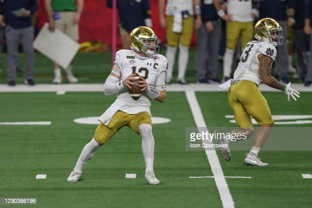 Notre Dame Fighting Irish quarterback Ian Book passes during the College Football Playoff Semifinal Rose Bowl Game between Notre Dame and Alabama on...