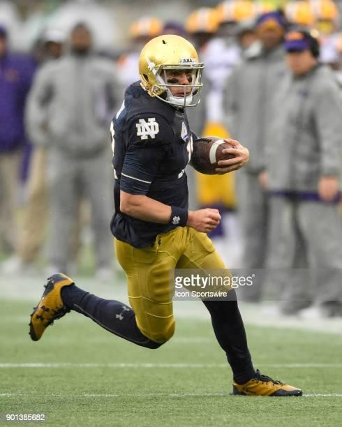 Notre Dame Fighting Irish quarterback Ian Book scrambles during the second half of the Citrus Bowl game between the Notre Dame Fighting Irish and the...