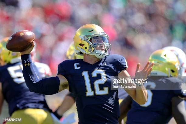 Notre Dame Fighting Irish quarterback Ian Book throws a pass during the first quarter of the college football game between the New Mexico Lobos and...