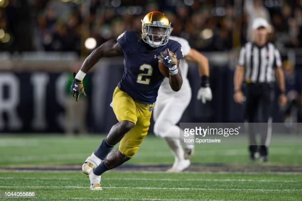 Notre Dame Fighting Irish running back Dexter Williams breaks free for a 45yard touchdown run during the college football game between the Notre Dame...