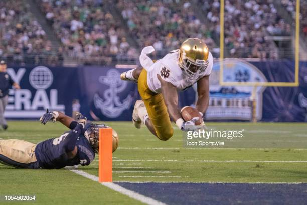 Notre Dame Fighting Irish running back Dexter Williams dives for a touchdown during a NCAA football game between the Notre Dame Fighting Irish and...