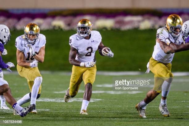 Notre Dame Fighting Irish running back Dexter Williams runs the ball during a college football game between the Notre Dame Fighting Irish and the...