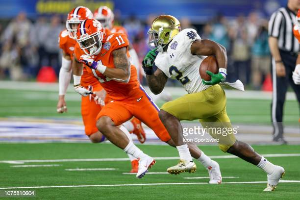 Notre Dame Fighting Irish running back Dexter Williams runs with Clemson Tigers safety Isaiah Simmons pursuing during the CFP Semifinal Cotton Bowl...