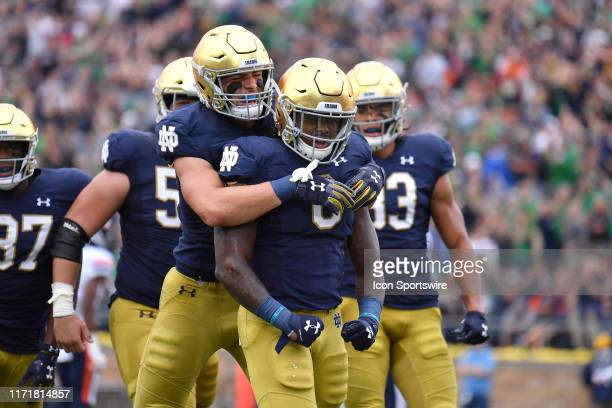 Notre Dame Fighting Irish running back Tony Jones Jr celebrates with teammates after scoring a touchdown in action during a game between the Notre...