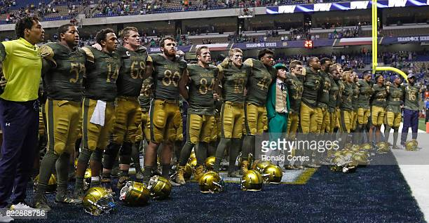 Notre Dame fighting Irish sings their school song after their game against Army during the second half of an NCAA college football game at the...