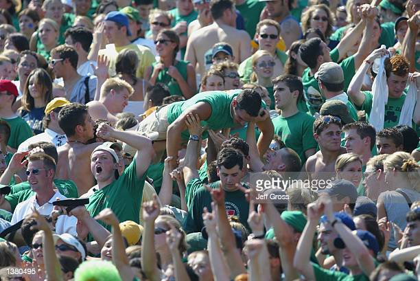 Notre Dame Fighting Irish students celebrate in the stands during the NCAA football game against the Purdue Boilermakers on September 7 2002 at Notre...