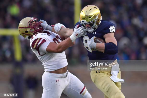 Notre Dame Fighting Irish tight end Cole Kmet battles with Boston College Eagles defensive end Marcus Valdez in game action during a game between the...