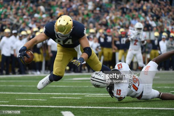 Notre Dame Fighting Irish tight end Cole Kmet battles with Bowling Green Falcons defensive back Jamari Bozeman to score a touchdown in game action...