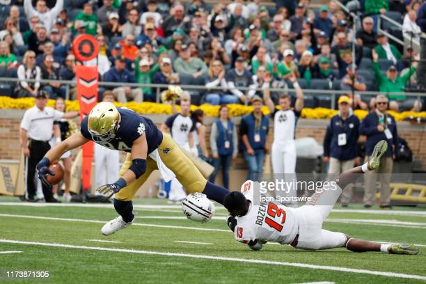 Notre Dame Fighting Irish tight end Cole Kmet catches a pass for a touchdown against Bowling Green Falcons defensive back Jamari Bozeman who has his...