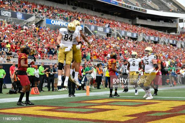 Notre Dame Fighting Irish tight end Cole Kmet celebrates a touchdown catch by Notre Dame Fighting Irish wide receiver Chase Claypool during the first...