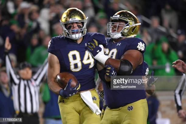 Notre Dame Fighting Irish tight end Cole Kmet celebrates with teammates after scoring a touchdown in game action during a game between Notre Dame...