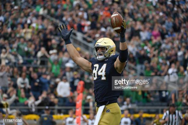 Notre Dame Fighting Irish tight end Cole Kmet celebrates with fans and teammates after scoring a touchdown in game action during a game between Notre...