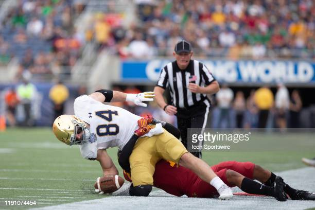 Notre Dame Fighting Irish tight end Cole Kmet is tackled awkwardly during the game between Notre Dame Fighting Irish and Iowa State Cyclones on...