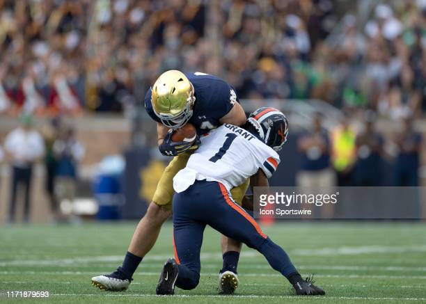 Notre Dame Fighting Irish tight end Cole Kmet is tackled by Virginia Cavaliers cornerback Nick Grant in action during a game between the Notre Dame...