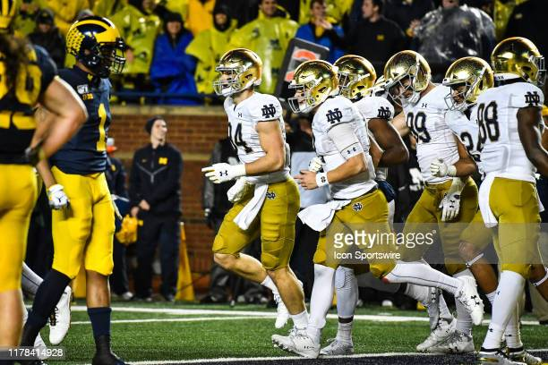Notre Dame Fighting Irish tight end Cole Kmet runs off with his teammates after a touchdown during the Michigan Wolverines versus Notre Dame Fighting...