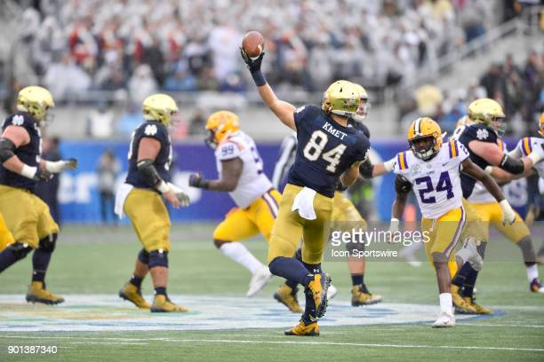 Notre Dame Fighting Irish tight end Cole Kmet throws a deep pass on a trick play while pressured by LSU Tigers linebacker Tyler Taylor during the...
