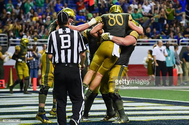 Notre Dame Fighting Irish tight end Durham Smythe is swarmed by teammates after his first half touchdown reception during the NCAA football game...