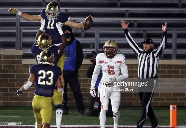 Notre Dame Fighting Irish wide receiver Ben Skowronek celebrates with his teammates after beating Boston College Eagles defensive back Deon Jones for...