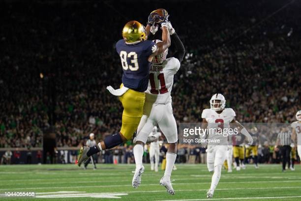 Notre Dame Fighting Irish wide receiver Chase Claypool and Stanford Cardinal cornerback Paulson Adebo battle for a pass in the end zone during the...