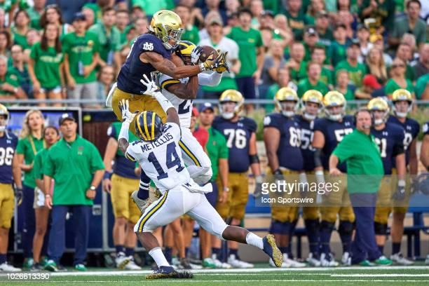 Notre Dame Fighting Irish wide receiver Chase Claypool battles with Michigan Wolverines defensive back Josh Metellus and Michigan Wolverines...