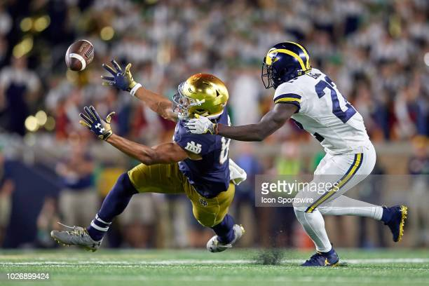 Notre Dame Fighting Irish wide receiver Chase Claypool battles with Michigan Wolverines defensive back David Long in attempt to catch the football in...