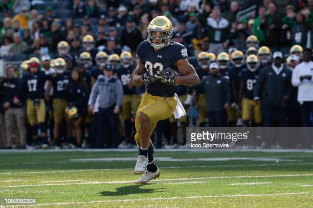 Notre Dame Fighting Irish wide receiver Chase Claypool makes a catch and runs it in for a 16yard touchdown during the college football game between...