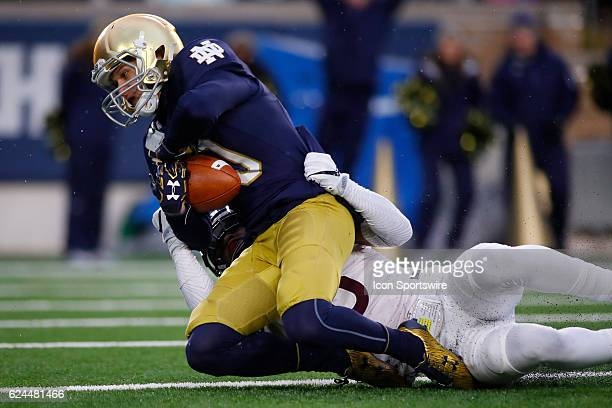 Notre Dame Fighting Irish wide receiver Chris Finke beats Virginia Tech Hokies safety Mook Reynolds to score a touchdown during the second quarter of...
