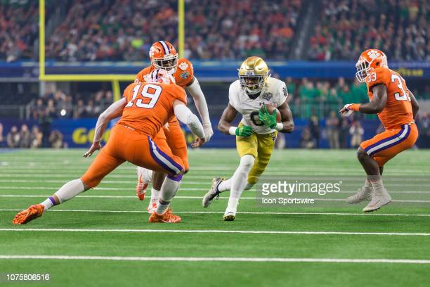 Notre Dame Fighting Irish wide receiver Jafar Armstrong tries to evade Clemson Tigers safety Tanner Muse and linebacker JD Davis during the CFP...