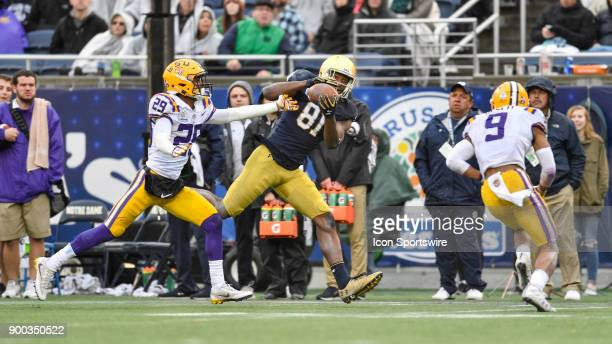 Notre Dame Fighting Irish wide receiver Miles Boykin catches a deep pass for a first down over the outstretched arms of LSU Tigers cornerback Andraez...