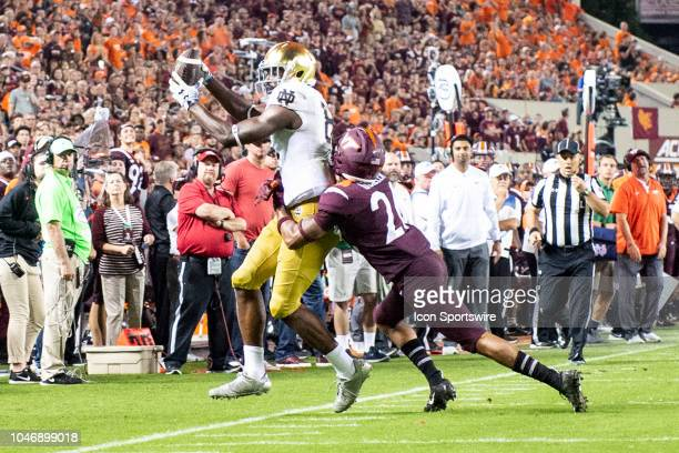 Notre Dame Fighting Irish Wide Receiver Miles Boykin catches the ball with Virginia Tech Hokies Defensive Back Jovonn Quillen defending during the...