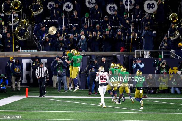 Notre Dame Fighting Irish wide receiver Miles Boykin celebrates with teammates in the endzone after scoring a touchdown in action during the first...